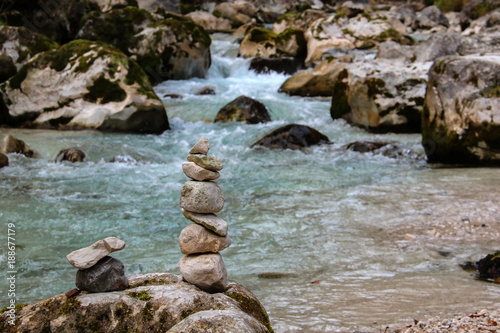 Fotobehang Bergrivier Columns, laid out of stones / Stormy stream / Mountain river
