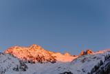 Alpine mountain ridges illuminated in golden hour in winter - 188685926