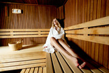 Young woman in sauna - 188694585