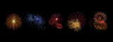 Color fireworks set light up on sky with dazzling display on black background. Event and celebrations background concept