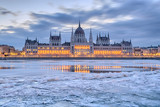 Winter twilight view of Budapest Parliament building over frozen Danube river - 188698977