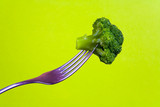 Broccoli is planted on a metal fork. - 188699133