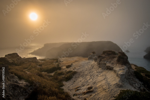 Foto Murales FOGGY SUNSET AND COASTAL SAND FORMATIONS NEAR MENDOCINO CALIFORNIA