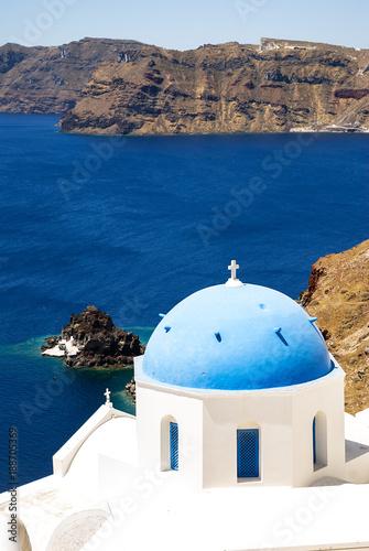 Fotobehang Santorini Blue roof church on Santorini island in Greece
