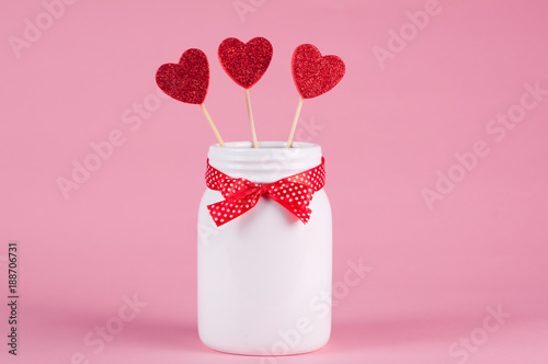 white jar with a red bow with hearts in for valentine's - 188706731