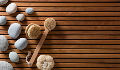 pebbles set on Turkish bath wooden board with body brushes © STUDIO GRAND WEB