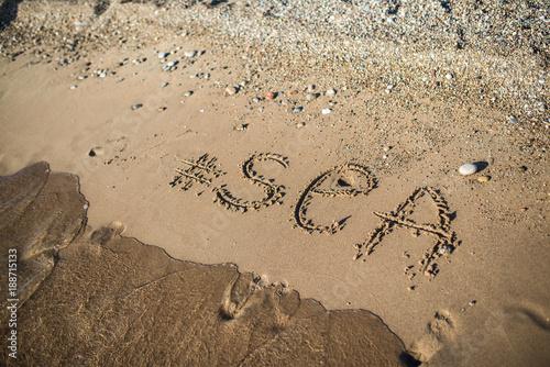 """The inscription on the sand """"sea"""""""