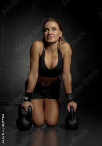 Fridge magnet Woman doing push-ups exercises on kettlebells