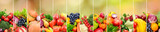 Fruits and vegetables on background of multicolored natural blurred background.