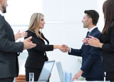 handshake business partners after discussion of the contract - 188738322