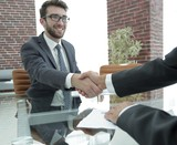 closeup. handshake between the financial Manager and the client - 188738952