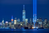 The two beams of the Tribute in Light with skycrapers of Financial District at night. Lower Manhattan, New York City - 188742565
