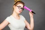 Woman holding big oversized pencil thinking about something - 188743154