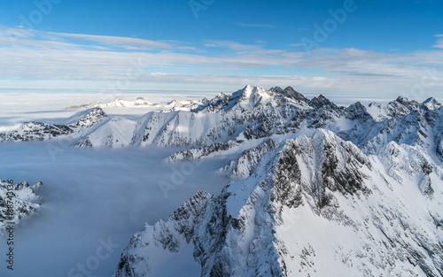 Fototapeta Sunny day in winter snowy Tatra mountains in Slovakia