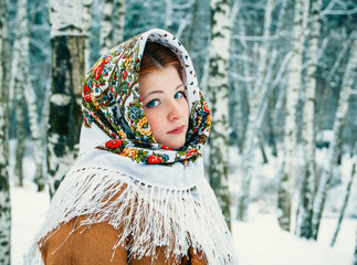 girl - Slavic appearance wrapped in a scarf in winter
