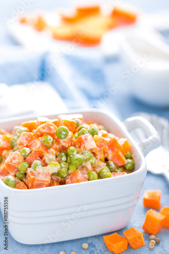 Poster Green peas stewed with carrots in creamy milk white sauce, vegetable stew
