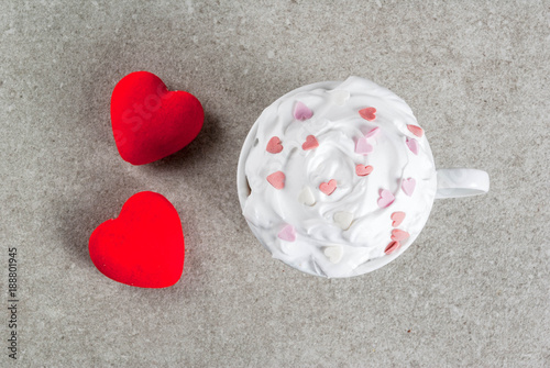 Deurstickers Chocolade Romantic background, Valentine's day. Cup for coffee or hot chocolate, with whipped cream and sweet hearts, with two plush red hearts, copy space top view
