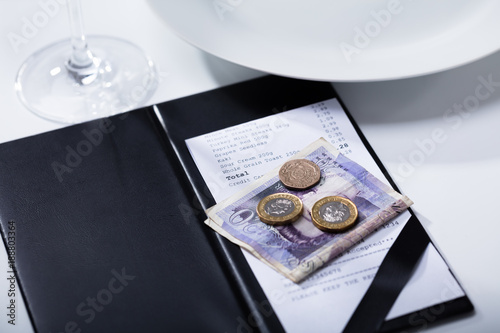 Pound Banknotes And Bill In Folder Payment On Table