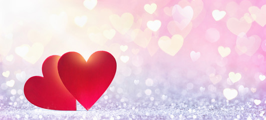 Valentine's Day background. Abstract red hearts in sunlight