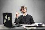 Serious man sitting at the desk. Teaching. - 188805132