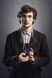 Man in vintage suit with retro camera. - 188806344