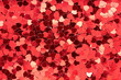 Aerial, top view of red heart shape glitter background
