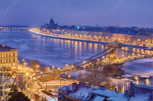 Winter twilight view of Budapest with Pest riverfront, Parliament domes outline and Chain bridge - 188818707