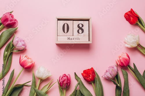 Calendar on the eighth of March to the women's day on a pink background with tulips. Flat lay and top view.