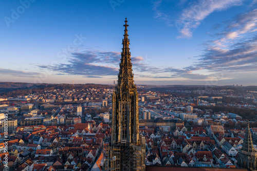 Leinwanddruck Bild Aerial shot taken with a drone of Ulm Minster at sunrise