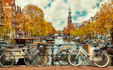 Bike over canal Amsterdam city. Picturesque town landscape