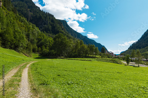 Fotobehang Gras Landscape of the Swiss valley at Rossa in the Grisons