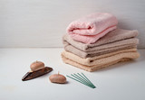 Colored towels soap and aromatic chopsticks for a spa on a white background - 188851764