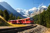 train in the scenic swiss alps around bernina and moteratsch glacier - 188852115