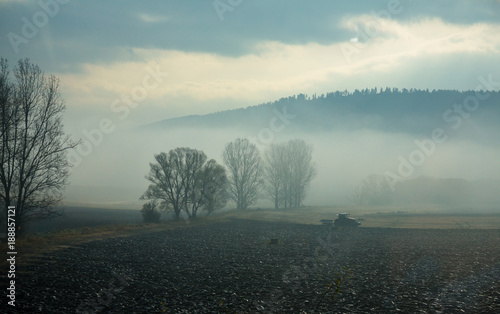 Fotobehang Trekker Tractor plowing soil in autumn