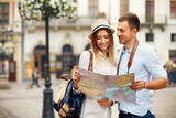 Couple With Map On Travel Vacations, Sightseeing - 188880760