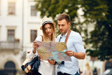 Couple With Map On Travel Vacations, Sightseeing - 188880925