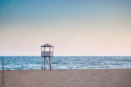Baywatch tower, in an empty beach - 188899327