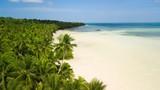 Aerial shot of white deserted tropical beach