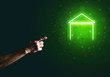 Conceptual image with hand pointing at house or main page icon on dark background