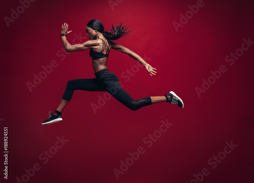 Female athlete running and jumping © Jacob Lund