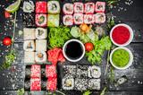 Fototapeta Maki -  Sushi sets on the table © Alexandr