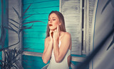Beautiful girl posing in her summer house - 188944394