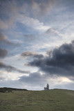 Stunning landscape image of Belle Tout lighthouse on South Downs National Park during stormy sky - 188947392