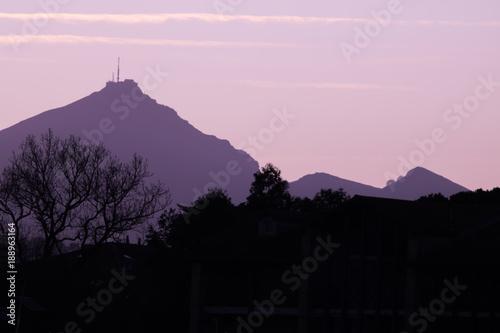 Fotobehang Lichtroze beautiful colorful sunrise sky above mountain La Rhune, basque country, france
