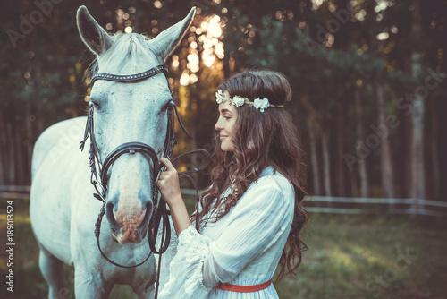Beautiful young woman and horse - 189013524