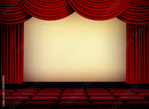 theater or cinema auditorium screen with red curtains and seats