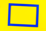 Blue color frame on bright yellow background. - 189023914
