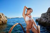summer sunny fashion portrait of pretty young sensual redhair woman posing in bikini