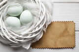 Three Easter eggs in the nest and blank handmade paper sheet - 189028951