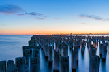 Old jetty pylons at dusk